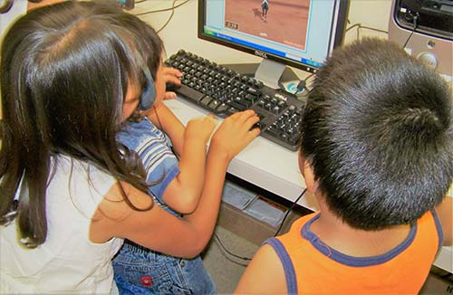 kids playing on computer