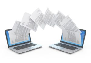 Graphic depicting transferring documents from one computer to another
