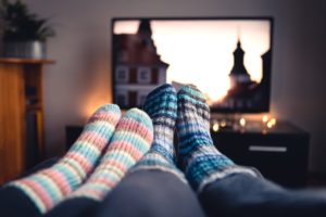 image of socks on feet in front of tv